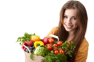 woman holding a bag full of healthy food. shopping